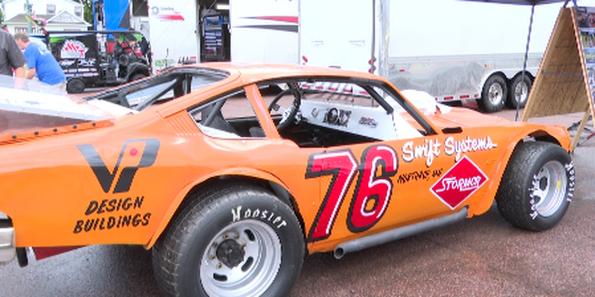 Motor sports enthusiasts restore race car