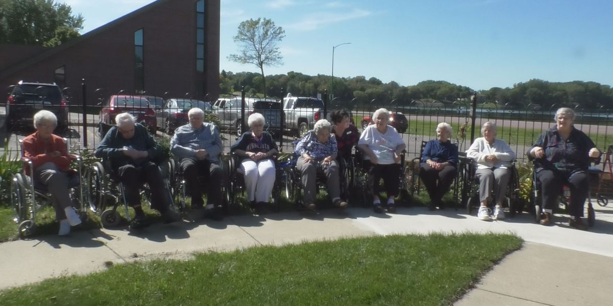 Local youth guide nursing home residents on a sunset walk