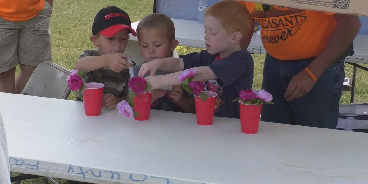 Children learn about pollination at youth conservation day
