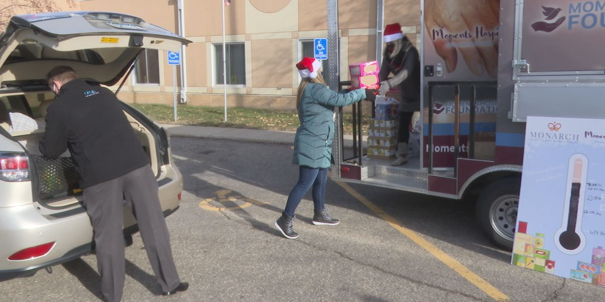 Moments Hospice trailer drives around Minnesota, helps stock local food shelves through donations