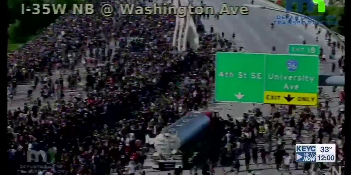 Truck driver charged after driving through crowd of protesters