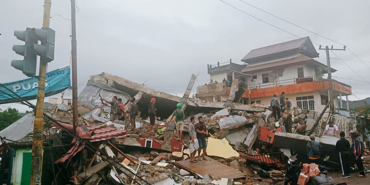 At least 15 dead as Indonesia quake topples homes, buildings