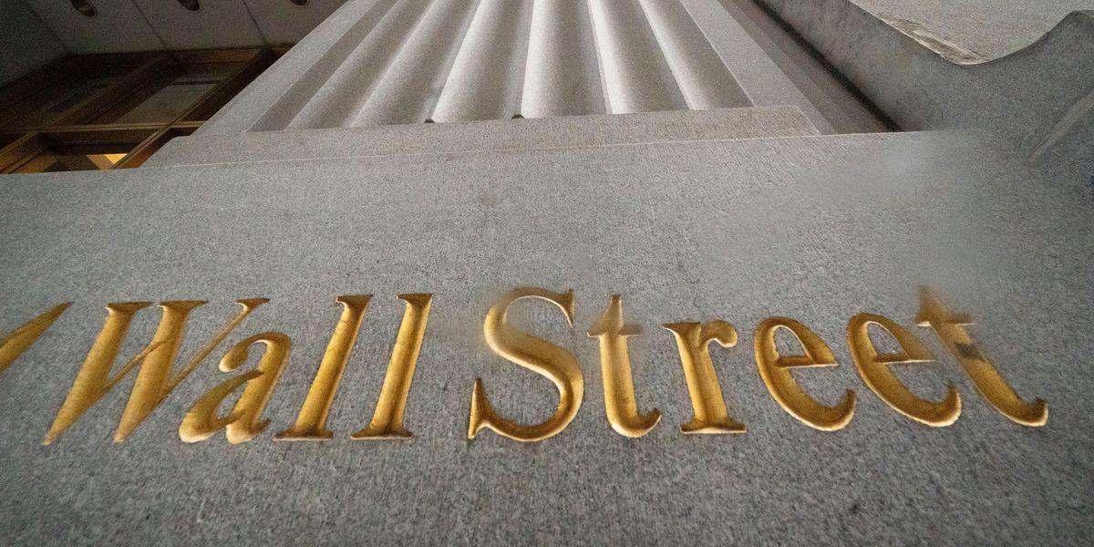 Wall Street hits records amid profit reports, inauguration