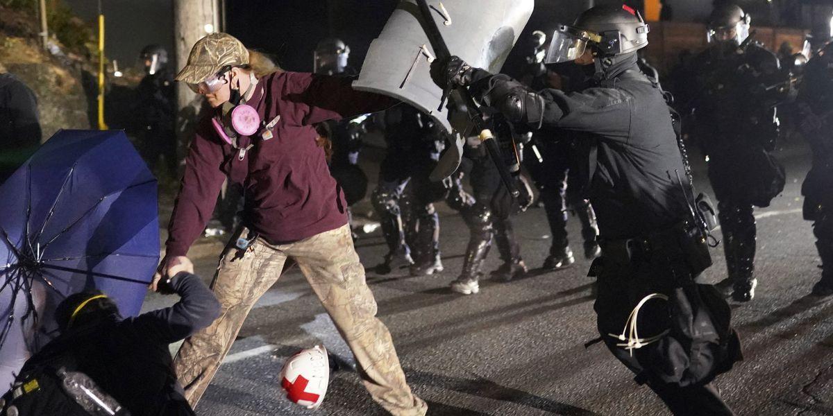 Riot declared as dumpster fires burn during protests in Portland, Oregon