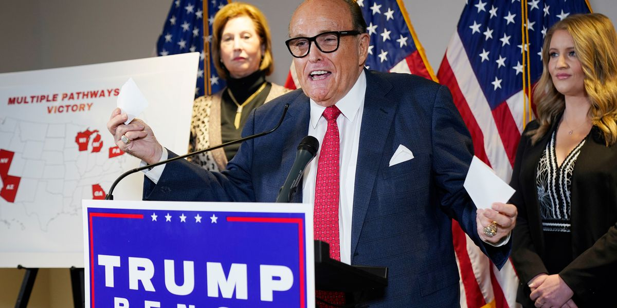 Giuliani search warrant resolved Justice Department dispute