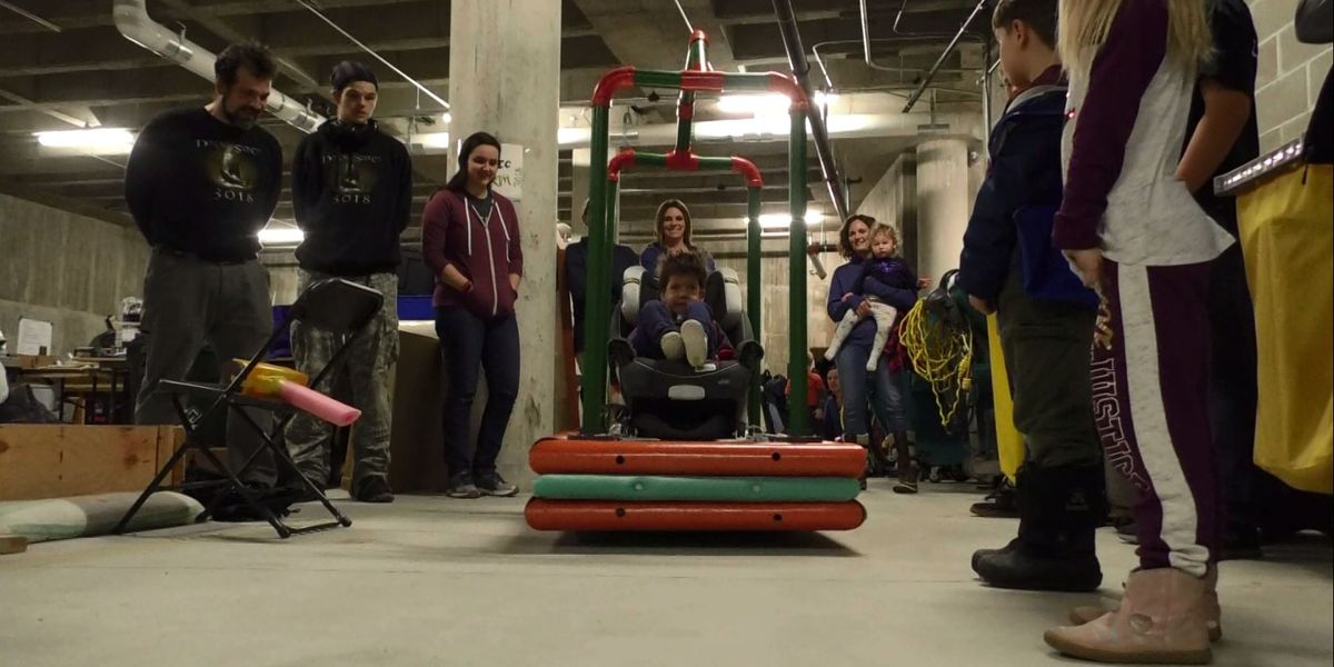 Gustavus Adolphus robotics students make, gift remote-controlled wheelchair for child
