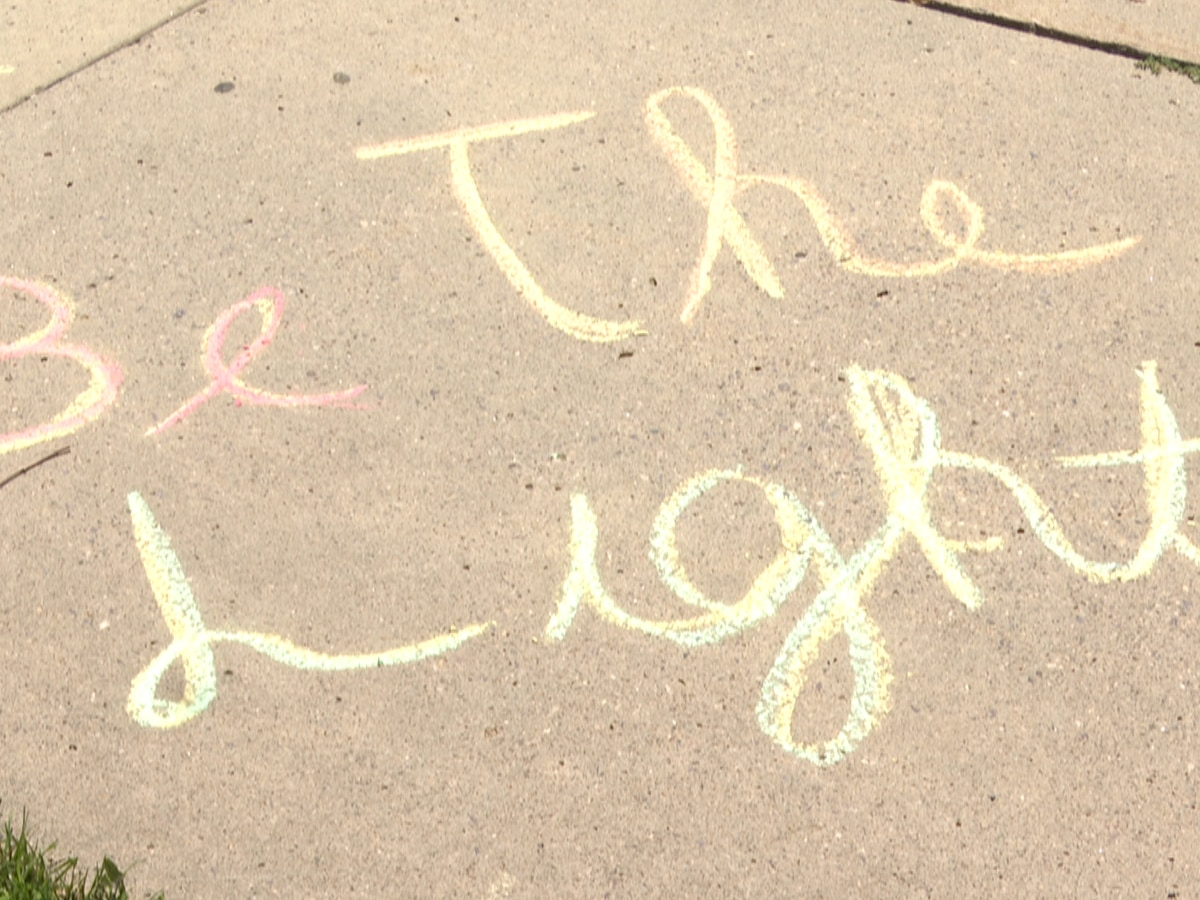 Students promote equality with sidewalk chalk