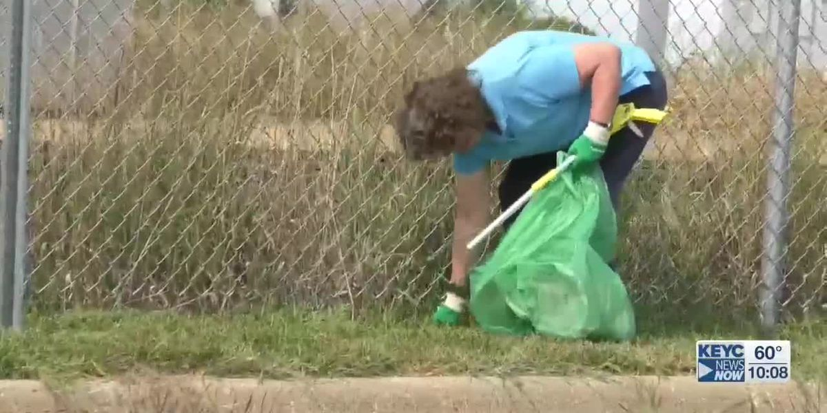 Community members partake in street clean up