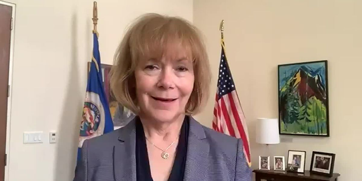 Sen. Tina Smith (D-MN) reacts to protests