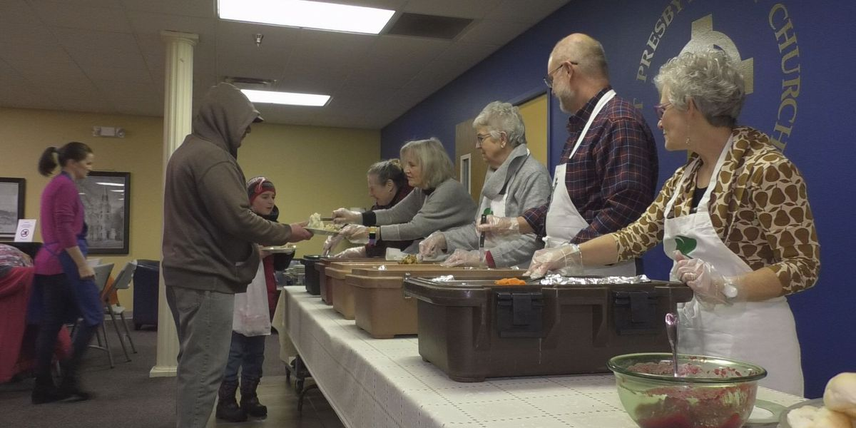 Community members give food and give thanks this Thanksgiving