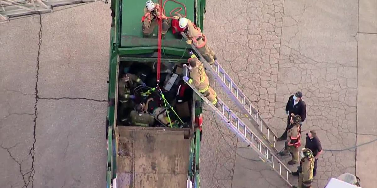 Rescue of man in garbage truck caught on camera - no sound